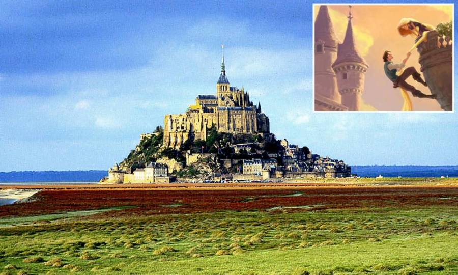 """FOR USE WITH """"TRAVEL MONT ST MICHEL""""--This is a  1997 view of Mont St. Michel, France. Through the ages, the mystery surrounding Mont St. Michel, a Gothic abbey perched high on a massive rock off France's Normandy coastline, has stretched far beyond its outstanding beauty. Now, almost 1,300 years after the first small shrine was built there, human development and tourism are posing a new threat. (AP Photo/Franck Prevel)...I"""